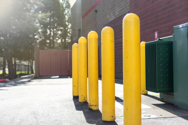 Yellow bollards for parking and restriction in a parking lot